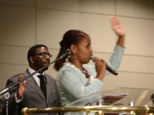 Psalmist Sybil Finney with Church of God in Christ, Auxiailaries in Ministry President Linwood Dillard in the background