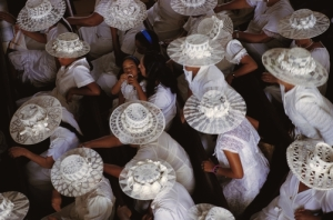 A bird's-eye view of women dressed all in white for church.